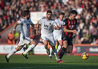 Bournemouth's Dominic Solanke (right) under pressure from Wolverhampton Wanderers' Joao Moutinho (left) & Ruben Neves (right) <br /> <br /> Photographer David Horton/CameraSport<br /> <br /> The Premier League - Bournemouth v Wolverhampton Wanderers - Saturday 23 February 2019 - Vitality Stadium - Bournemouth<br /> <br /> World Copyright © 2019 CameraSport. All rights reserved. 43 Linden Ave. Countesthorpe. Leicester. England. LE8 5PG - Tel: +44 (0) 116 277 4147 - admin@camerasport.com - www.camerasport.com