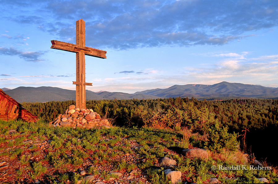 Wooden cross at edge of the village of Truchas, New Mexico in the Sangre de Cristo Mountains of New Mexico, between Santa Fe and Taos, NM