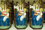 The Walsingham Pilgrimage. Statues of Our Lady of Walsingham on sale in gift shop, at the Roman Catholic Slipper Chapel shrine. Little Walsingham north Norfolk England 2006