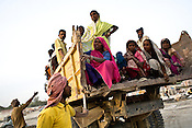 Migrant labourers are loaded onto the truck after the days' work at the construction site of the Asia's Biggest Dome, the Kashi Ram Smarak built by Uttar Pradesh chief minister, Mayawati in Lucknow, India. The dalit chief minister, Mayawati is channeling huge state funds into making statutes of herself with her mentor, Kashi Ram all across Lucknow.