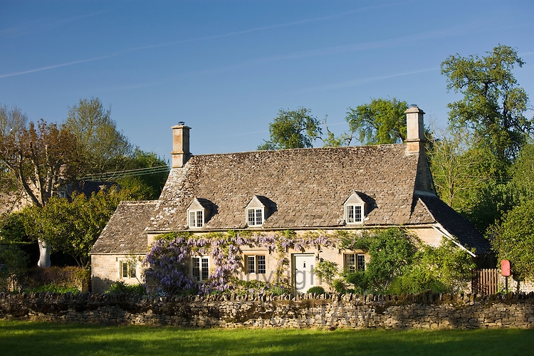 Traditional quaint village stone period cottage in Taynton, The Cotswolds, Oxfordshire, UK
