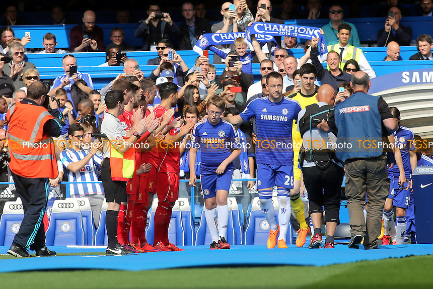 Liverpool players form a guard of honour as Chelsea captain, John Terry walks past with the mascot - Chelsea vs Liverpool - Barclays Premier League Football at Stamford Bridge, London - 10/05/15 - MANDATORY CREDIT: Paul Dennis/TGSPHOTO - Self billing applies where appropriate - contact@tgsphoto.co.uk - NO UNPAID USE