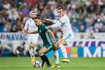 Gareth Bale of Real Madrid (R) fights for the ball with Riza Durmisi of Real Betis (L) during the La Liga 2017-18 match between Real Madrid and Real Betis at Estadio Santiago Bernabeu on 20 September 2017 in Madrid, Spain. Photo by Diego Gonzalez / Power Sport Images
