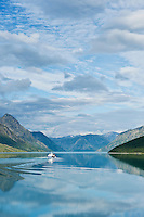 Passenger ferry boat travel from Gjendesheim towards Memurubu on Lake Gjende, Jotunheimen national park, Norway
