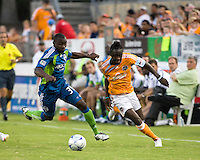 Seattle Sounders defender Jhon Kennedy Hurtado (34) and Houston Dynamo forward Kei Kamara (10) sprint for the ball.  Houston Dynamo tied Seattle Sounders 1-1 on August 23, 2009 at Robertson Stadium in Houston, TX.