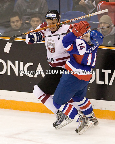 Gunars Skvorcovs (Latvia - 13), Samuel Mlynarovic (Slovakia - 14) - Team Slovakia defeated Team Latvia 8-3 on Sunday, December 27, 2009, at Credit Union Centre in Saskatoon, Saskatchewan, during the 2010 World Juniors tournament.