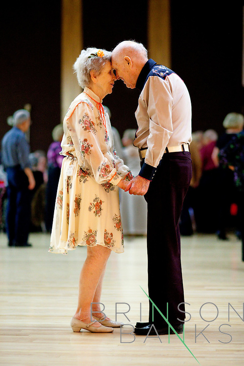 "Nicky Morrison, 87, and Will Rowling, 95, stay face to face after the dance floor clears before another waltz or fox trot start at the weekly Singles Dance at the Sundial Auditorium in Sun City, Arizona. Nicky decided a year ago that she would teach Will how to dance. ""We've known each other for a year and we're gonna go on forever,"" Will said. Both dancers are very little vision."