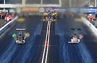 Feb. 18, 2012; Chandler, AZ, USA; NHRA top fuel dragster driver Terry McMillen (left) races alongside Clay Millican during qualifying for the Arizona Nationals at Firebird International Raceway. Mandatory Credit: Mark J. Rebilas-