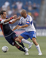 Montreal Impact forward Marco Di Vaio (9) dribbles to avoid New England Revolution defender AJ Soares (5). In a Major League Soccer (MLS) match, Montreal Impact defeated the New England Revolution, 1-0, at Gillette Stadium on August 12, 2012.
