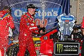 #18: Kyle Busch, Joe Gibbs Racing, Toyota Camry Skittles Red White & Blue celebrates in victory lane
