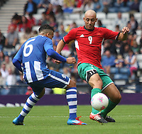 Men's Olympic Football match Honduras v Morocco on 26.7.12...Noureddine Amrabat of Morocco beats Arnold Peralta of Honduras, during the Honduras v Morocco Men's Olympic Football match at Hampden Park, Glasgow.........