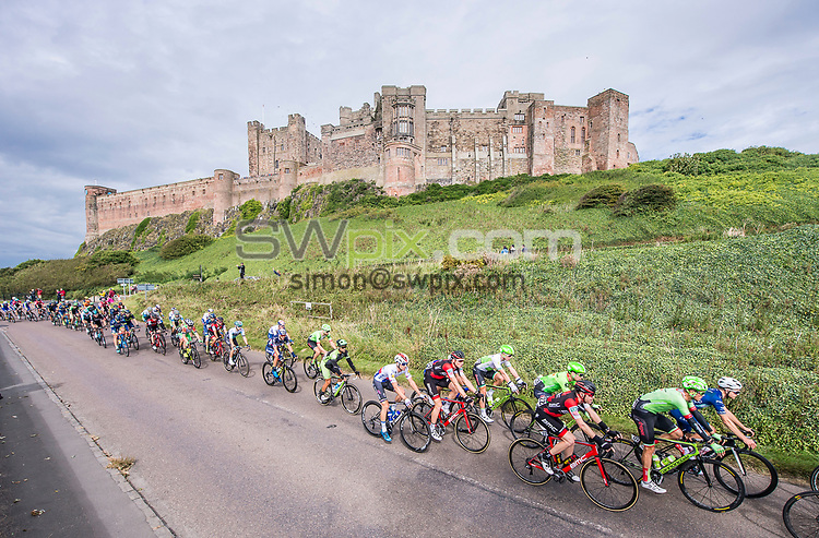 Picture by Allan McKenzie/SWpix.com - 04/09/2017 - Cycling - OVO Energy Tour of Britain - Stage 2 Kielder Water to Blyth - The peloton passes in front of Bamburgh Castle.