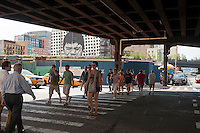 Visitors cross under the trestle on Tenth Avenue in New York on Saturday, August 18, 2012 after leaving the northern terminus of the High Line Park at West 30th Street.. (© Richard B. Levine)