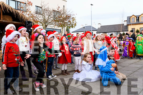 Waiting for Santa's Arrival<br /> The kids from Fame Stage School sing and dance wonderfully to entertain the huge crowd as they wait for Santa to arrive by Fire Engine at Library Place Killorglin on Saturday.
