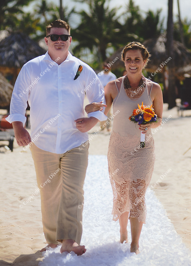Travis Ova and Hayley Brazil make their way up the aisle during Allison & Jared's wedding ceremony on Friday
