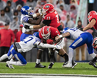 ATHENS, GA - OCTOBER 19: D'Andre Swift #7 of the Georgia Bulldogs is tackled by Cedrick Dort Jr. #27 and Kash Daniel #56 of the Kentucky Wildcats during a game between University of Kentucky Wildcats and University of Georgia Bulldogs at Sanford Stadium on October 19, 2019 in Athens, Georgia.
