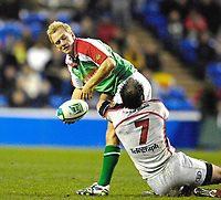 Reading, GREAT BRITAIN,   Shane GERAGHTY, feelt the weight of Kieron DAWSON's tackle, during the third round Heineken Cup game, London Irish vs Ulster Rugby, at the Madejski Stadium, Reading ENGLAND, Sa, t 09.12.2006. [Photo Peter Spurrier/Intersport Images]..