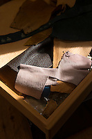 Pieces of leather used in the restoration of samurai armour. Robert Soanes Japanese Armour and Antiques Restorer, Brighton, UK, May 6, 2016. Craftsman Robert Soanes specializes in the restoration and conservation of samurai armour, swords and other Japanese fine art. He lives and works in the English seaside resort of Brighton.