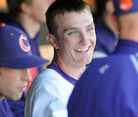 Starting pitcher Matthew Crownover (44) of the Clemson Tigers smiles in the dugout after pitching in a game against the Wofford Terriers on Wednesday, March 6, 2013, at Doug Kingsmore Stadium in Clemson, South Carolina. Clemson won, 9-2, with freshman Crownover picking up his first win.  (Tom Priddy/Four Seam Images)