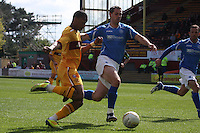 Chris Humphrey takes on Alan Maybury in the Motherwell v St Johnstone Clydesdale Bank Scottish Premier League match played at Fir Park, Motherwell on 28.4.12.