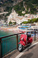 Vintage red Vespa at the seaside historic village of Amalfi, on the Unesco World Heritage Listed Amalfi Coast, Italy