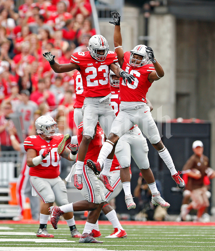 Ohio State Buckeyes safety Tyvis Powell (23) celebrates his blocked field goal with Ohio State Buckeyes defensive back Cam Burrows (16) in the 1st quarter of their game at Ohio Stadium on September 26, 2015.  (Dispatch photo by Kyle Robertson)
