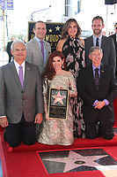 HOLLYWOOD, CA - October 06: Debra Messing, Mariska Hargitay, Max Mutchnick, Leron Gubler, At Debra Messing Honored With Star On The Hollywood Walk Of Fame At On The Hollywood Walk Of Fame In California on September 06, 2017. <br /> CAP/MPI/FS<br /> &copy;FS/MPI/Capital Pictures