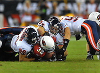 Oct. 16, 2006; Glendale, AZ, USA; Chicago Bears linebacker (54) Brian Urlacher , safety (30) Mike Brown and linebacker (92) Hunter Hillenmeyer tackle Arizona Cardinals running back (32) Edgerrin James at University of Phoenix Stadium in Glendale, AZ. Mandatory Credit: Mark J. Rebilas