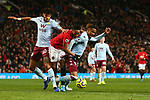 Tyrone Mings and Ezra Konsa of Aston Villa battle Anthony Martial of Manchester United during the Premier League match at Old Trafford, Manchester. Picture date: 1st December 2019. Picture credit should read: Phil Oldham/Sportimage