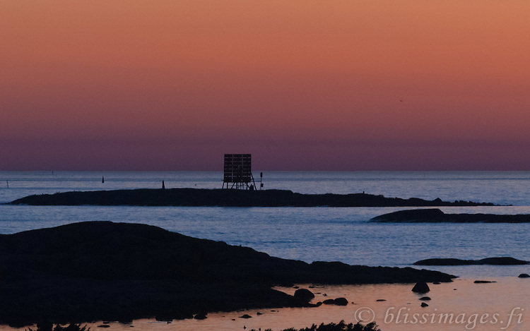During the early hours of pre-dawn this leading mark is silhouetted off Pookinmaa Island, Finland, where Lyökki Daybeacon resides.Photo taken at about 2:00 am.
