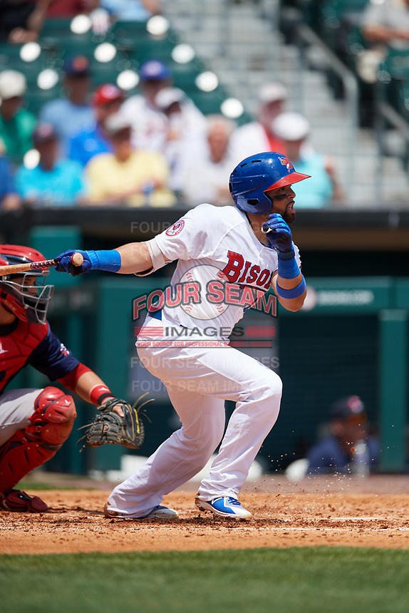 Buffalo Bisons catcher Michael De La Cruz (43) follows through on a swing in front of catcher Oscar Hernandez (7) during a game against the Pawtucket Red Sox on June 28, 2018 at Coca-Cola Field in Buffalo, New York.  Buffalo defeated Pawtucket 8-1.  (Mike Janes/Four Seam Images)