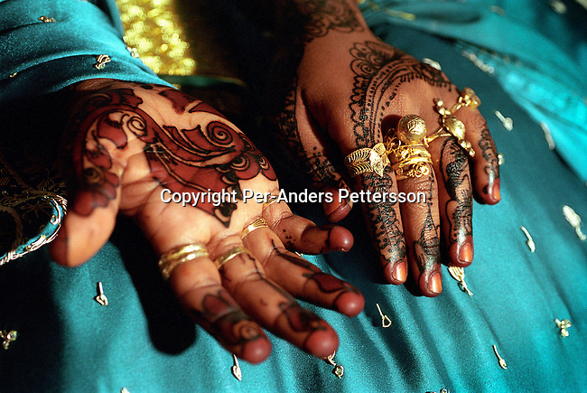 An unidentified bride waits for her husband to arrive for a Muslim wedding ceremony, on October 6, 2002 in a house in Zanzibar Town on Zanzibar, Tanzania. Zanzibar is mainly Muslim and the woman is entering a traditional wedding that takes a few days. (Photo by: Per-Anders Pettersson)