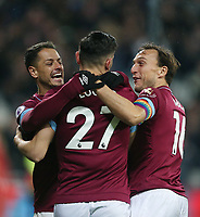 West Ham United's Lucas celebrates scoring his side's first goal with Javier Hernandez and Mark Noble<br /> <br /> Photographer Rob Newell/CameraSport<br /> <br /> The Premier League - West Ham United v Cardiff City - Tuesday 4th December 2018 - London Stadium - London<br /> <br /> World Copyright © 2018 CameraSport. All rights reserved. 43 Linden Ave. Countesthorpe. Leicester. England. LE8 5PG - Tel: +44 (0) 116 277 4147 - admin@camerasport.com - www.camerasport.com