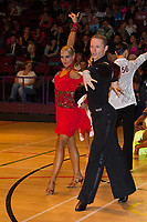 Evgueni Chaoulski and Sara Schilling from Canada perform their dance during the professional latin-american risint stars competition of the International Championships held in Brentwood Leisure Centre, Brentwood, United Kingdom on 11. October 2011. ATTILA VOLGYI