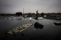A keyboard lies in a polluted lagoon at Agbogbloshie dump, which has become a dumping ground for computers and electronic waste from all over the developed world. Hundreds of tons of e-waste end up here every month. It is broken apart, and those components that can be sold on, are salvaged.