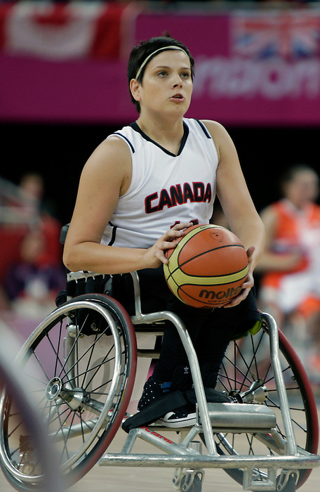 LONDON, ENGLAND 08/31/12: Katie Harnock competes in the Women's Wheelchair Basketball preliminary round CAN vs NED at the London 2012 Paralympic Games at the North Greenwich Arena (Photo by: Wheelchair Basketball Canada/Canadian Paralympic Committee)