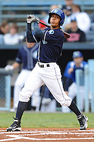 Asheville Tourists Rafael Ortega #5 swings at a pitch during a game against  the Lexington Legends at McCormick Field in Asheville,  North Carolina;  April 16, 2011. Lexington defeated Aheville 13-7.  Photo By Tony Farlow/Four Seam Images
