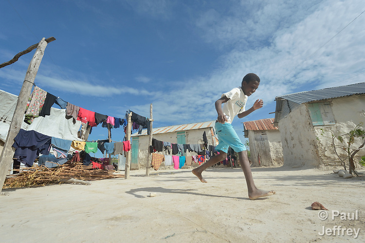 A boy plays hopscotch in the Haitian community of Ganthier, where Servicio Social de las Iglesis Dominicanas, a member of the ACT Alliance, has built hundreds of homes and helped families rebuild the local economy during the first year after the devastating passage of Hurricane Matthew in 2016.