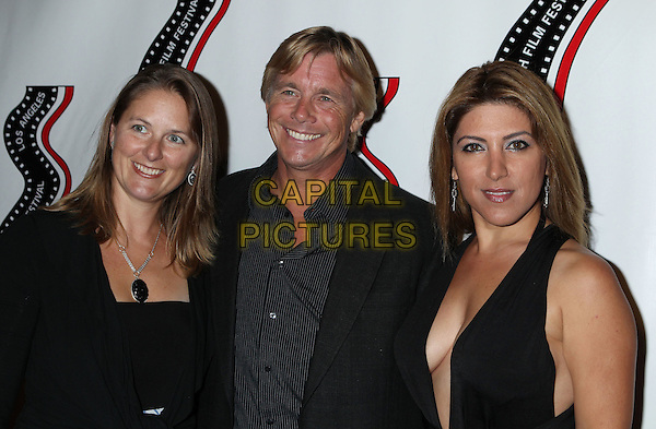 guest, Christopher Atkins, Michelle Alexandria <br /> 13th annual Polish film festival at American Cinematheque's Egyptian Theatre, Hollywood, California, USA.<br /> 9th October 2012<br /> headshot portrait black shirt suit jacket stripe cleavage <br /> CAP/ADM/RE<br /> &copy;Russ Elliot/AdMedia/Capital Pictures