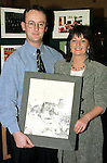 Michael Black presenting a picture to Tharisa Kilroy of herself when she was in the majorettes at the 40th anniversary of the Lourdes Brass Band and Majorettes.