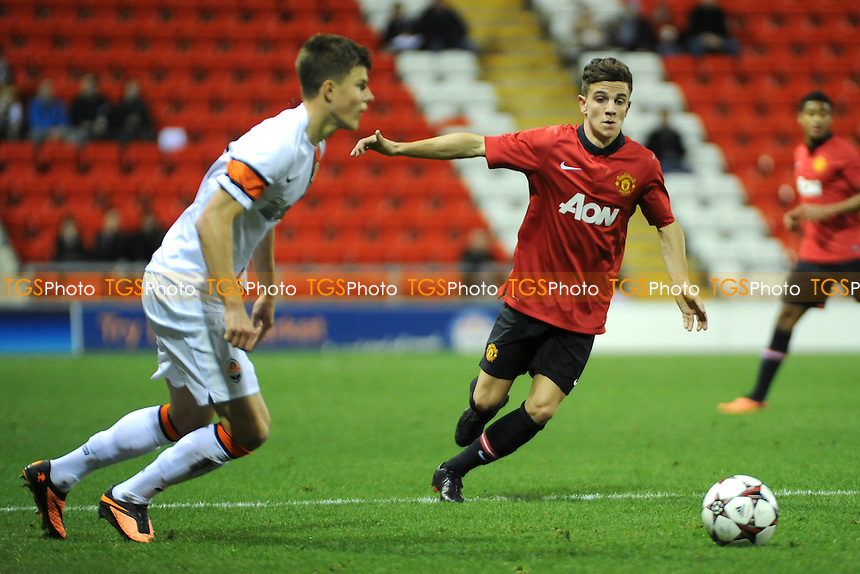 Joshua Harrop of Manchester United closes down Eduard Sobol of Shakhtar Donetsk - Manchester United Under-19 vs Shaktar Donetsk Under-19- UEFA Youth League Football at Leigh Sports Village - 09/12/13 - MANDATORY CREDIT: Greig Bertram/TGSPHOTO - Self billing applies where appropriate - 0845 094 6026 - contact@tgsphoto.co.uk - NO UNPAID USE