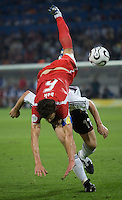 Jacek Bak of Poland sails over the head of Miroslav Klose of Germany at FIFA World Cup Stadium, Dortmund, Germany, June 14, 2006.