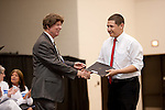 Steve Mead presents Aldo Amaya with his scholarship from the Aldine Optimist Club at the 2011 Aldine Scholarship Foundation Scholarship Ceremony at Lone Star College - North Harris.