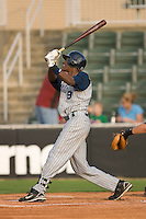 Abner Abreu #9 of the Lake County Captains follows through on his swing versus the Kannapolis Intimidators at Fieldcrest Cannon Stadium May 1, 2009 in Kannapolis, North Carolina. (Photo by Brian Westerholt / Four Seam Images)