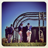 SURPRISE, AZ - MARCH 3:  Instagram of manager Ron Washington of the Texas Rangers talking to Seattle Seahawks quarterback Russell Wilson behind the batting cage during spring training on March 3, 2014 in Surprise, Arizona. Photo by Brad Mangin