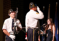 NWA Democrat-Gazette/DAVID GOTTSCHALK  LB (cq) Teeter (from left), Paul Bridges, both retired Air Force and members of American Legion Post 100 of Rogers Color Guard, stand at attention Wednesday, November 11, 2015, as Alex Bryan sends the National Anthem during the Hour with a Hero Veterans Day event at Har-Ber High School in Springdale. The event, presented by the Environmental and Spatial Technology students at the school, recognized military men and women through the day during hour long assemblies.