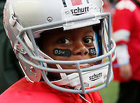 Brian Hodge, 9, of Columbus, who plays wide receiver on his team, wore his full uniform to Saturday's NCAA Division I football game between the Ohio State Buckeyes and the Rutgers Scarlet Knights at Ohio Stadium in Columbus on Saturday, Oct. 18, 2014. (Dispatch Photo by Barbara J. Perenic)