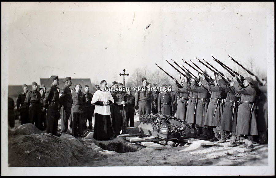 BNPS.co.uk (01202 558833)<br /> Pic: PeterWilson/BNPS<br /> <br /> The burial of a British prisoner who was shot by German guards.<br /> <br /> A fascinating photo album has to come to light to reveal what went on inside a German POW camp - including stage shows in drag.<br /> <br /> The Stalag Luft IV B album was compiled by British prisoner David Courtney, of 102 Squadron, whose Halifax was shot down near Berlin on January 20, 1944.<br /> <br /> One of the photos shows the funeral of a British soldier who was assassinated by the German guards, although they have taken part in the ceremony by lifting their guns above the coffin.<br /> <br /> Another shows a theatre performance put on by inmates where the performers were dressed as women to keep up morale.