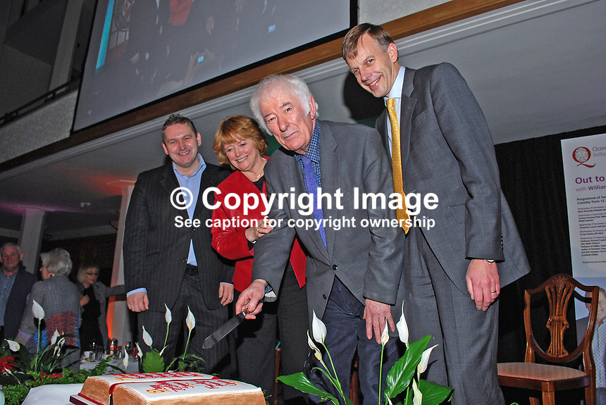 Nobel Laureate Seamus Heaney who is this year celebrating his 70th birthday ceremonially cuts a birthday cake, a gesture from his friends at Queen's University, Belfast, where he was a lecturer in Modern English Literature during the 60's. The occasion was a lunch followed by Heaney being interviewed by broadcaster William Crawley, left, also in the photograph.  Also included are Heaney's wife, Marie, and Queen's vice-chancellor, Peter Gregson. 200912023167.<br />