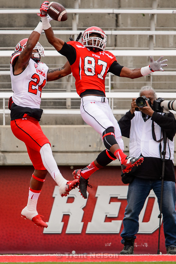 Trent Nelson  |  The Salt Lake Tribune<br /> Jawuan Mathis pulls in an end zone interception ahead of Kenric Young at the Utah Football Red &amp; White game in Salt Lake City, Saturday April 25, 2015. Rick Bowmer